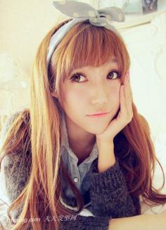 圆脸女生专属发型 新年长卷发显甜美