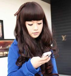 齐刘海长发卷发发型图片